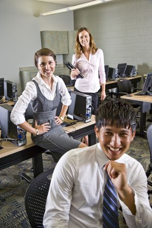 Three university students hanging out in computer room photo