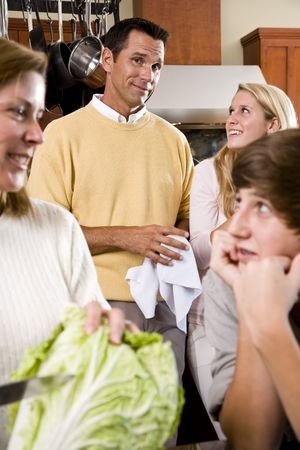 Closeup of family with two teenage children in kitchen Stock Photo - 6865056