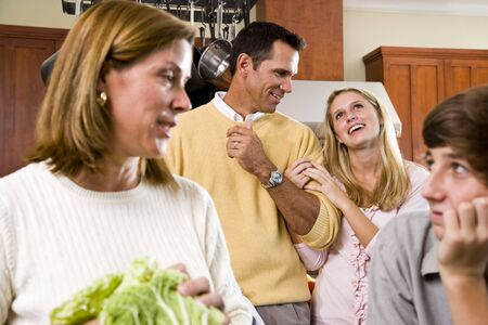 Close-up of family with two teenage children in kitchen Stock Photo - 6865125