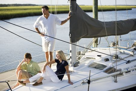 boating: Family vacation together on sailboat on sunny day, on Florida intracoastal waterway