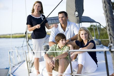 Family vacation together on sailboat, on Florida intracoastal waterway photo