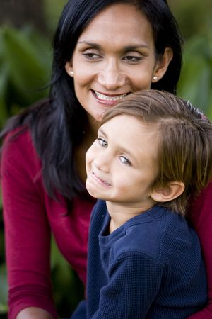 Close-up of loving Indian mother with young cute mixed-race 5 year old son photo