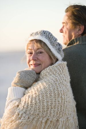 Senior woman with husband dressed in warm clothing photo