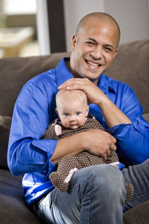 bald girl: Happy dad with 3 month old baby sitting on lap