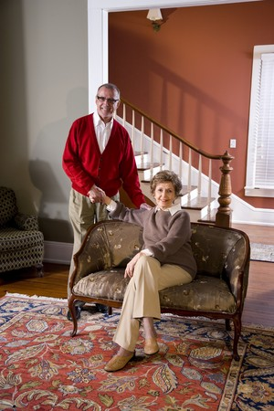 Portrait of senior couple at home in living room Stock Photo - 7181898