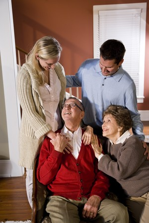 Portrait of senior couple at home on sofa with adult children Stock Photo - 7181899