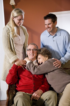 Portrait of senior couple at home on sofa with adult children Stock Photo - 7181900