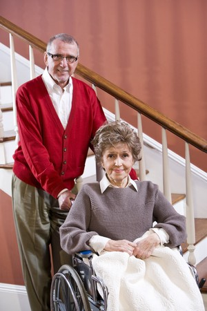 Senior couple at home, woman in 70s in wheelchair Stock Photo - 7181856