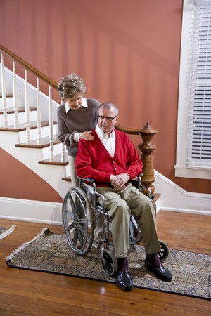 Serious senior couple at home, man in wheelchair Stock Photo - 7181877
