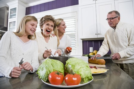 Three generation family in kitchen serving lunch, talking and laughing Stock Photo - 7181791