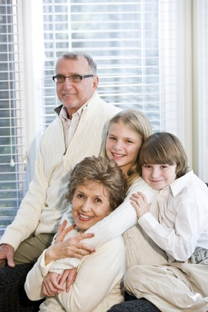 Family portrait of two children with grandparents photo