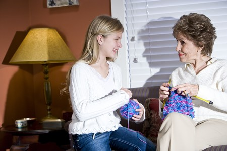 Girl with grandmother knitting at home in living room Stock Photo - 7181795