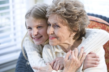 Portrait of happy grandmother with grandchild hugging Stock Photo - 7095859