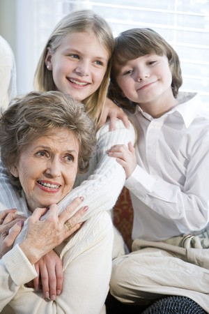 Close up portrait of children with grandmother together photo