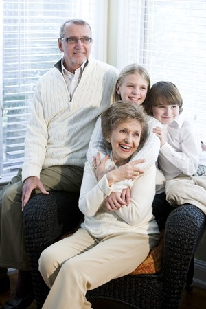 Portrait of children with grandparents together at home photo