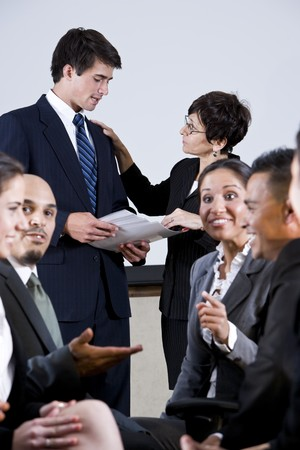 Diverse group of businesspeople conversing, exchanging ideas photo
