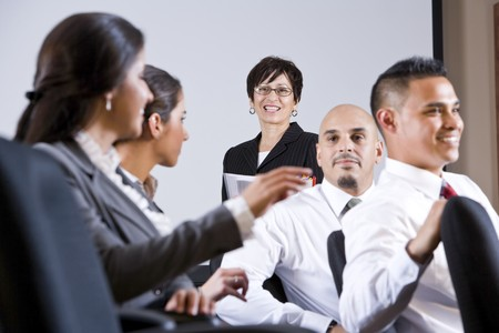 Diverse group of businesspeople watching presentation Stock Photo