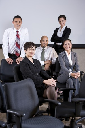 Mature Hispanic businesswoman leading group of younger office workers Stock Photo - 7159168