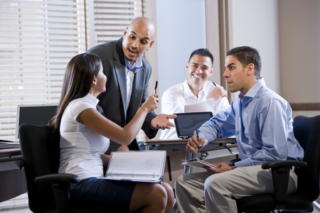 Hispanic business manager meeting with office workers, giving directions photo