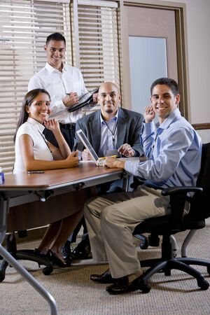 office workers: Happy office workers meeting at table in boardroom working together Stock Photo
