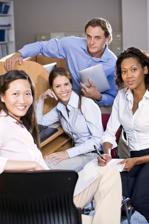 Diverse university students at library computer studying Stock Photo - 7159190