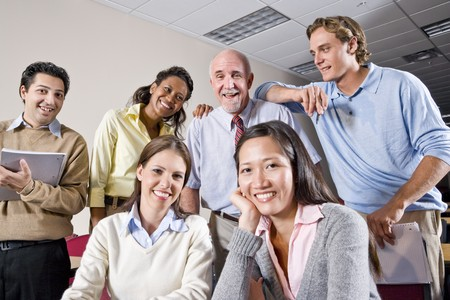 university professor: Multiracial group of college students and teacher in class Stock Photo