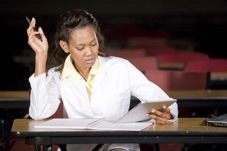 African American medical student studying at night in classroom Stock Photo - 7159138