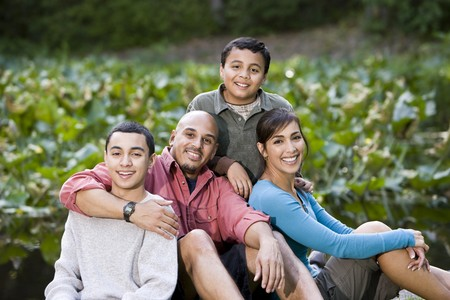 Portrait of happy Hispanic family with two boys outdoors Foto de archivo