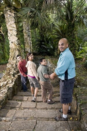 Hispanic family with two boys walking down stairs outdoors Stock Photo - 7319143