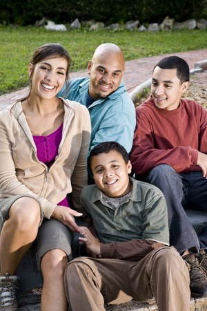 Portrait of Hispanic family with two boys outdoors Stock Photo - 7319105