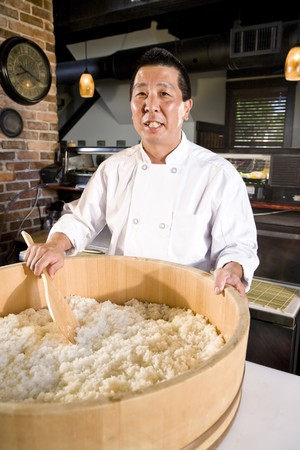 japanese cooking: Japanese chef preparing rice for sushi in restaurant