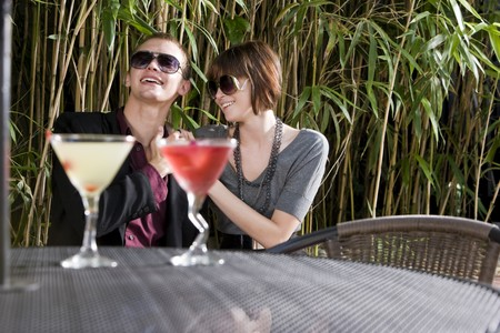 Young romantic couple having cocktails on patio Stock Photo - 7420902