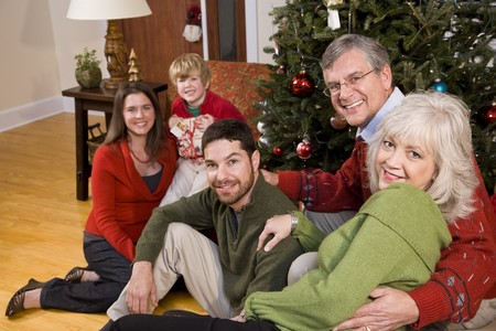three generations: Three generations - family holiday gathering by Christmas tree