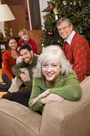 three generations: Senior woman with family by Christmas tree - three generations Stock Photo