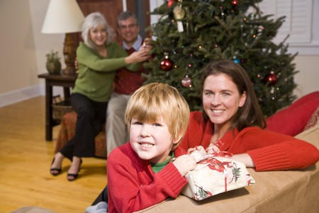 three generations of women: Happy boy with mother and grandparents at Christmas