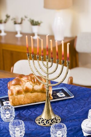 jewish: Still life of Chanukah menorah lit on table