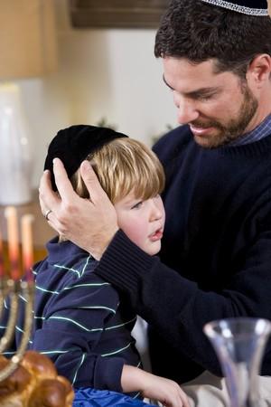 yarmulke: Affectionate father and 4 year old son celebrating Hanukkah