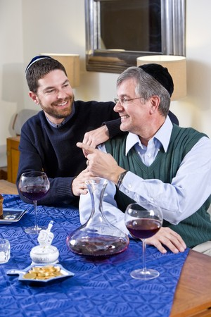 Senior Jewish man and adult son celebrating Hanukkah Stock Photo - 7635051