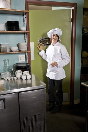 Chef working in restaurant standing at kitchen doorway Stock Photo - 7698872