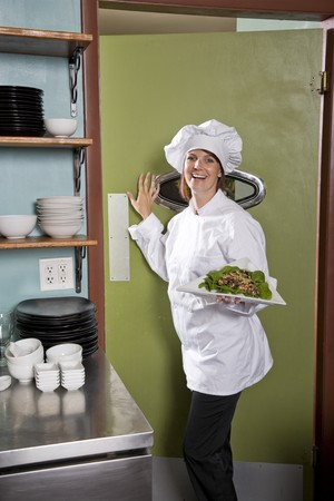 Chef working in restaurant standing at kitchen doorway with gourmet salad place Stock Photo - 7698870