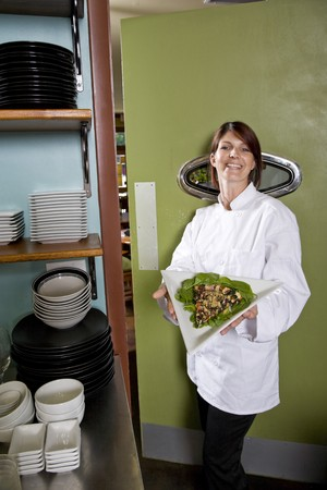 Chef working in restaurant standing at kitchen doorway with gourmet salad place Stock Photo - 7698880