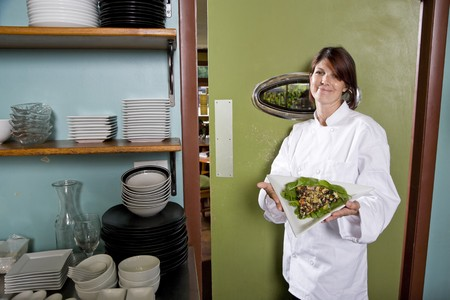 Chef working in restaurant standing at kitchen doorway with gourmet salad place Stock Photo - 7698888
