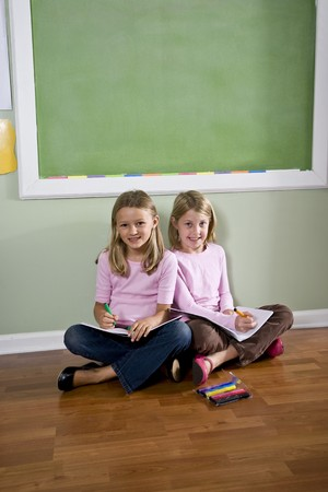 Back to school - two 8 year old girls doing homework together photo