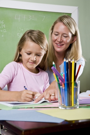 Back to school - 8 year old student and teacher writing in classroom Stock Photo - 7826660
