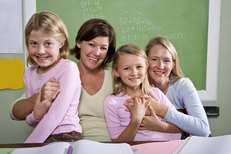 Back to school - teachers and elementary students in classroom, 8-9 years old Stock Photo