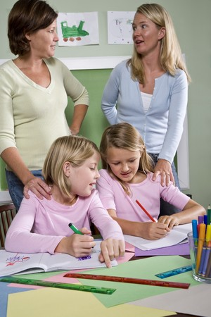 home schooling: Back to school - teachers and elementary students in classroom, 8-9 years old Stock Photo