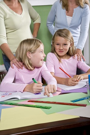 Back to school - teachers and elementary students in classroom, 8-9 years old Stock Photo - 7826680
