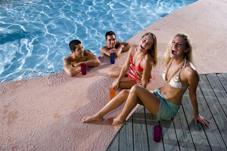 Young adult friends laughing together by swimming pool Stock Photo - 8064018