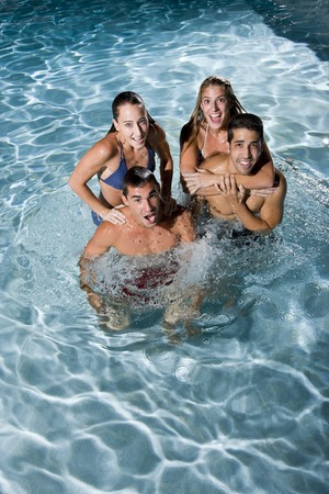Young adults (20s) having fun in swimming pool at night Stok Fotoğraf - 8167726