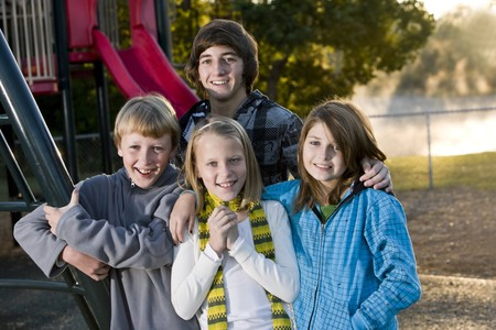 Group of children (10 to 15 years) standing together on playground on chilly day Stock Photo - 8167713